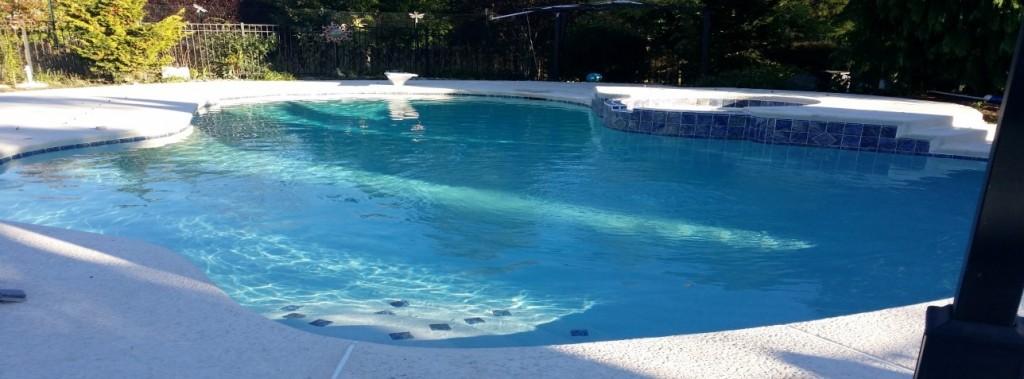slide (11) - pool resurfacing, tile installation, cool deck, kool deck, pool coping