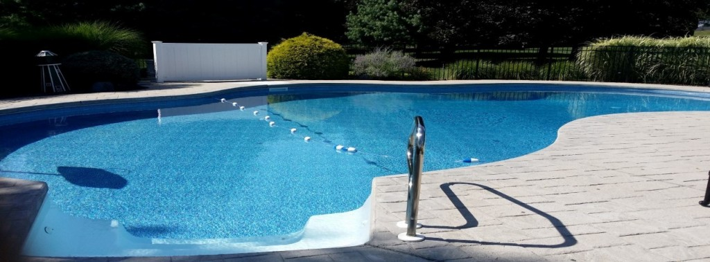 slide (12) - liner replacement, pool liner renovation, pool coping, pool decking, paver installation, skimmer replacement