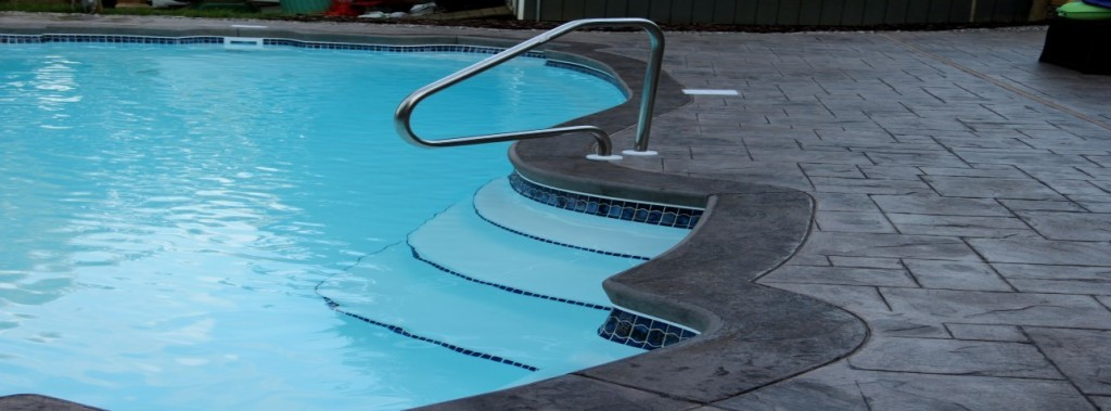 slide (19) - concrete pool renovation, artistic stamped concrete, pool coping, pool decking