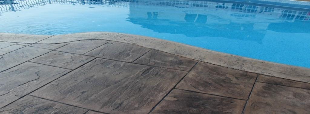 slide (20) - pool renovation, residential concrete pool renovation, stamped concrete installation.